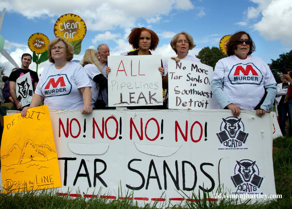 The Detroit Coalition Against Tar Sands, Ann Arbor 350 Local, Michigan Coalition Against Tar Sands, and others from across MI, protested in front of the Marathon tar sands refinery where they formed a human chain, delivering the people's demands.  PHOTO/DAYMONJHARTLEY.COM