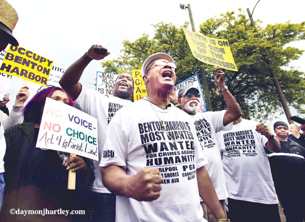 Rev. Pinkney (center) at PGA protest against corporate redevelopment of Benton Harbor, MI which is creating greater poverty.  PHOTO/DAYMONJHARTLEY.COM