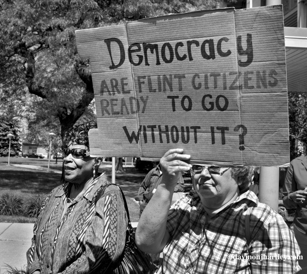 """Protest for an end to Emergency Manager """"dictatorship"""" law in Flint and across the state. People rally on the lawn of Flint's City Hall. PHOTO/DAYMONJHARTLEY.COM"""