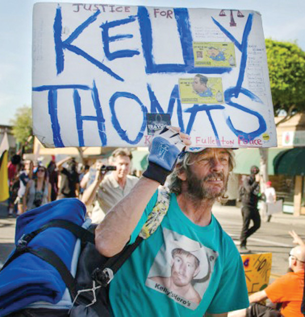 A march to protest the not guilty verdict of two Fullerton, CA police officers after their acquittal in the Kelly Thomas trial. Thomas was a homeless, mentally ill man who was murdered by police. A video recording showed the deadly beating. PHOTO/ETHAN HAWKES, DAILY TITAN
