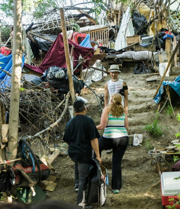 "People in Silicon Valley, home to the billionaire tech giants, work with people who live in the ""Jungle,"" the largest homeless tent city in the nation, to clean up on Earth Day. PHOTO/SILICON VALLEY DE-BUG"