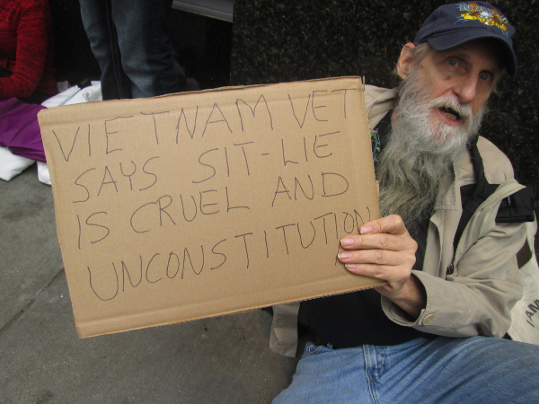 "Member of Veterans for Peace at a protest organized by ""First they came for the homeless,"" against San Francisco's 'Sit/Lie' law that makes it illegal to sit or lie on public sidewalks.  PHOTO/SARAH MENEFEE"