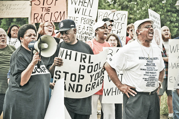 Rev. Pinkney (center) at a protest against corporate redevelopment of Benton Harbor, MI, which is creating greater poverty. PHOTO/BRETT JELINEK