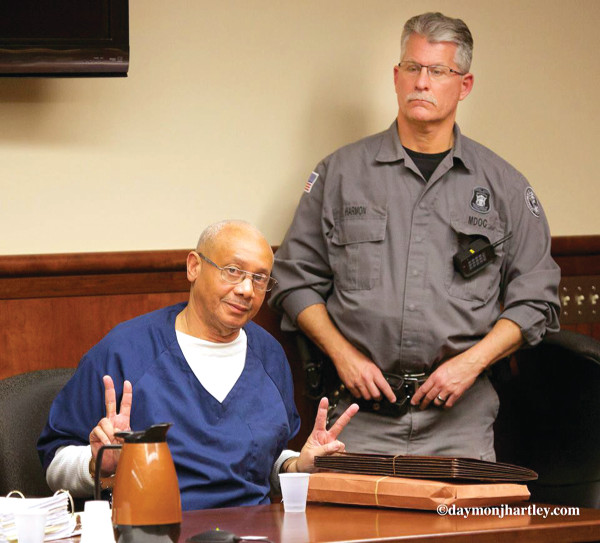 Rev. Edward Pinkney was handcuffed and ushered into the courtroom on the day of a hearing by two prison guards. The crowd of supporters in the courtroom immediately stood up and clapped (before the sheriff warned them to stop). Attend the next hearing on April 14 at 8:30 a.m. at the Berrien County Courthouse in St. Joseph, MI. PHOTO/DAYMONJHARTLEY.COM