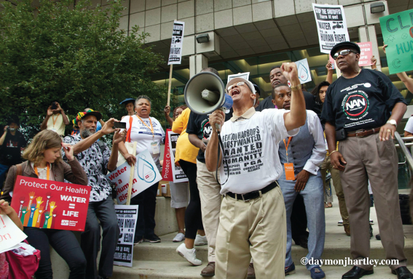 Rev. Pinkney speaking at a rally for water rights in Detroit, Michigan. PHOTO/DAYMONJHARTLEY.COM