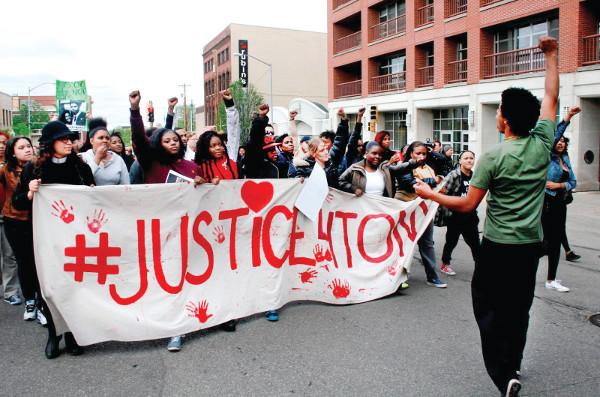 Protest in Madison following the announcement that the police officer that killed Tony Robinson would not be charged. PHOTO/LESLIE AMSTERDAM
