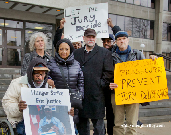 In a threat to democracy and the jury system, two of nine protesters charged with disorderly conduct as they blocked trucks hired by the city from leaving their facility to turn off the water of Detroit's poorest families, had their trial abruptly stopped shortly before it went to the jury. PHOTO/DAYMONJHARTLEY.COM