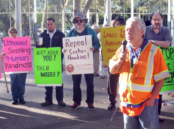 Salvador Munoz of the Laborers Local 270 speaks at rally against displacement in Silicon Valley. PHOTO/SANDY PERRY