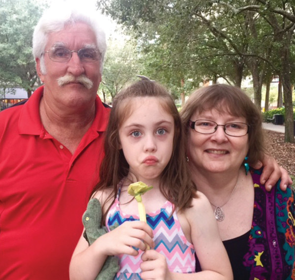 Richard William Pete of Hands Up Ministries with his girlfriend, Tracy and her granddaughter, Chloe in St. Petersburg, Florida. PHOTO/???