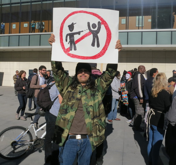 Protesting armed guards at high schools in Los Angeles. PHOTO/???