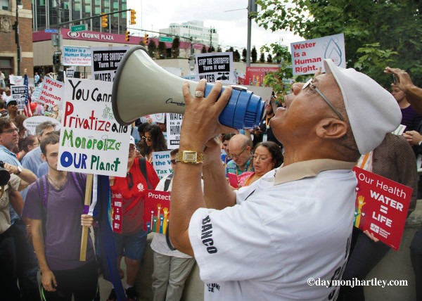 Rev. Pinkney speaks at protest over water cutoffs in Detroit. PHOTO/DAYMONJHARTLEY.COM