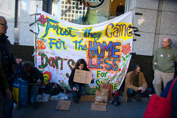 "The homeless-led group, First They Came For The Homeless, protests San Francisco's notorious ""sit/lie""law outside of Macy's, a big supporter of the law.  PHOTO/PETER MENCHINI"