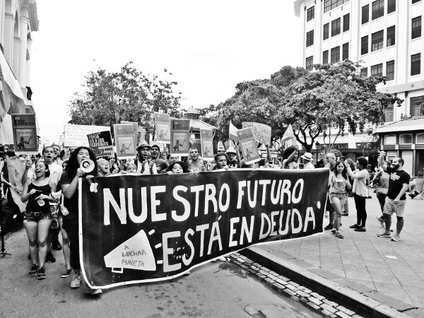 "May Day March in Puerto Rico against the country's emergency managers' policies. The banner in the photo says, ""Indebtedness is our future."" PHOTO/PEDRO ANGEL RIVERA"