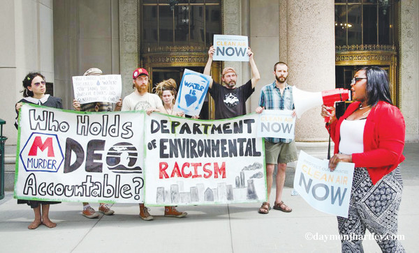 Groups gather at Detroit's Michigan Department of Environmental Quality office to denounce the poisoning of water, dumping of poisons in sewage system, and expansion of hazardous waste plant. PHOTO/DAYMONJHARTLEY.COM
