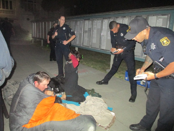 "Two young homeless men are arrested for sleeping (""lodging"") at the Liberty City2 homeless rights protest at Berkeley City Hall. PHOTO/SARAH MENEFEE"