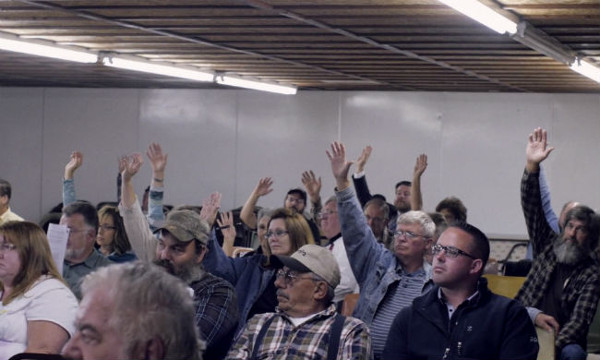 The show of hands reflects people's decision to reject an injection well in the town of Grant Township in Pennsylvania. People also passed legislation legalizing civil disobedience. PHOTO/ INVISIBLE HAND DOCUMENTARY© JOSHUA B. PRIBANIC FOR PUBLIC HERALD