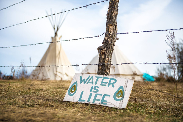 A scene from the Sacred Stone Camp, started in April to protect the Standing Rock Sioux's water from the Dackota Access Pipeline, which threatens the water of over 17 million people downstream from contamination by fracked oil. PHOTO/BRETT JELINEK