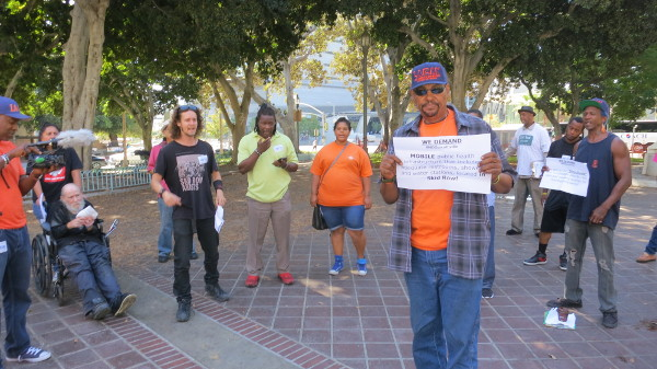 Protest in front of City Hall demanding housing and services for the homeless living on Skid Row. PHOTO/CHRIS VENN