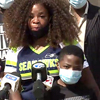 Cynthia Haynes with her son Daniel at Flint press conference