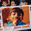 banner with Adam Toledo photo
