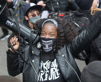 Woman protesting holding a megaphone