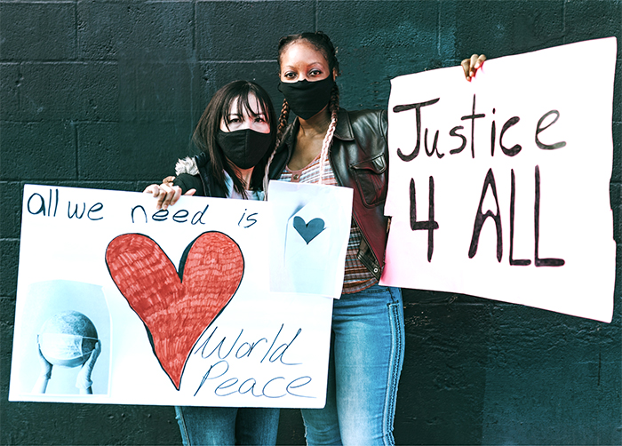 2 demonstrators with signs