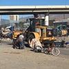 Heavy equipment destroys a houseless community