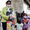 Migrant mother with her children in Tijuana