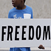 boy holding Freedom sign