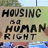 sign that reads housing is a human right