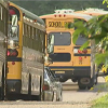 line of school buses in Flint